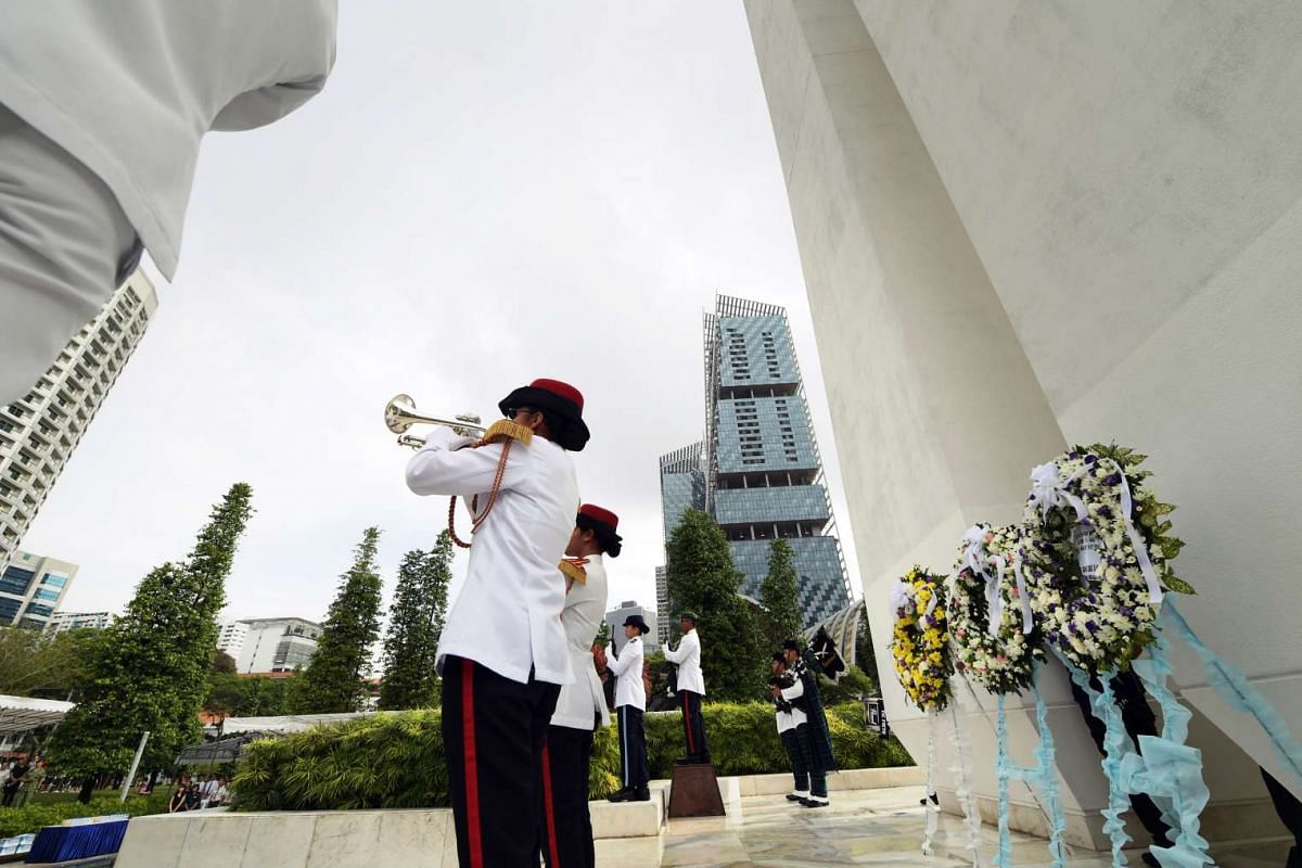Buglers from the NCC Command Band of Swiss Cottage Secondary School sounding The Last Post at the Memorial to the Civilian Victims during the 50th War Memorial Service as a remembrance of the victims who perished during the Japanese Occupation of Sin