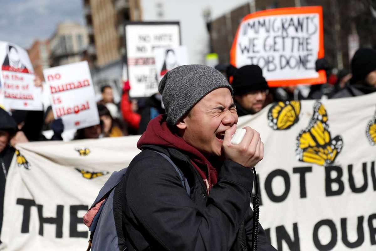 """Demonstrators march during the """"Day Without Immigrants"""" protest in Washington, DC, U.S., February 16, 2017. PHOTO: REUTERS"""
