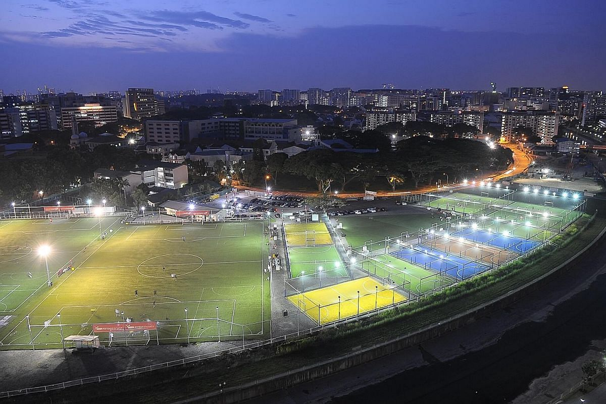Children playing on the pitch at The Cage (above). The Home United Youth Football Academy (left) has 12 pitches.