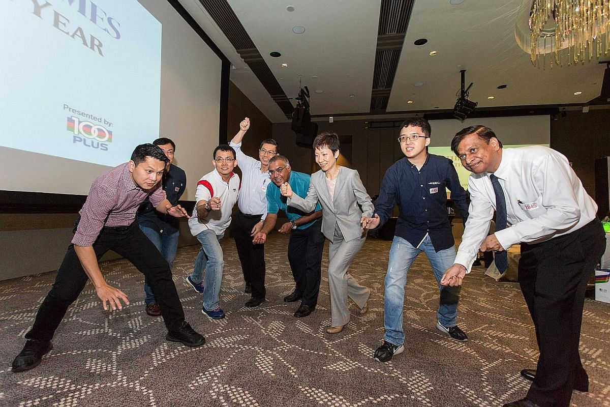 Culture, Community and Youth Minister Grace Fu sportingly engages in a mannequin challenge with some Straits Times readers during the ST Athlete of the Year award ceremony at the One Farrer Hotel & Spa Grand Ballroom yesterday.