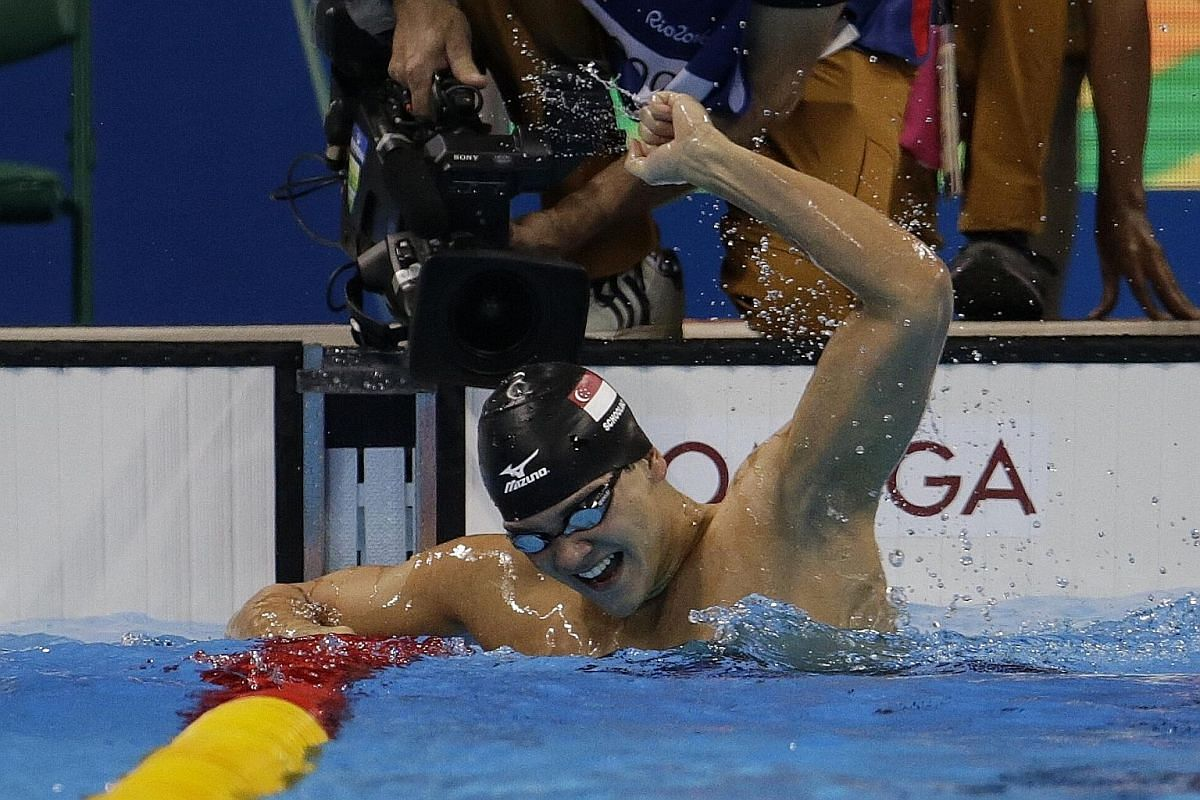 Joseph Schooling celebrates after winning the 100m butterfly gold medal at the Rio Olympics last year. The swimmer is the first person to win the title of The Straits Times Athlete of the Year more than once.