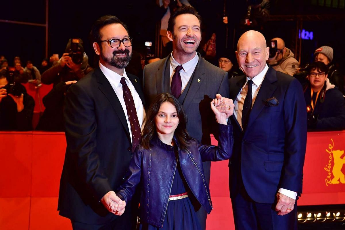 Director James Mangold (left) with Logan stars Hugh Jackman (centre), Dafne Keen (in front) and Patrick Stewart (right) on the red carpet during the premiere of the film at the 67th Berlinale film festival in Berlin on Feb 17, 2017.
