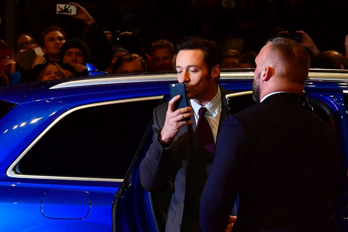 Hugh Jackman greets fans as he arrives for the premiere of the film Logan at the 67th Berlinale film festival in Berlin on Feb 17, 2017.