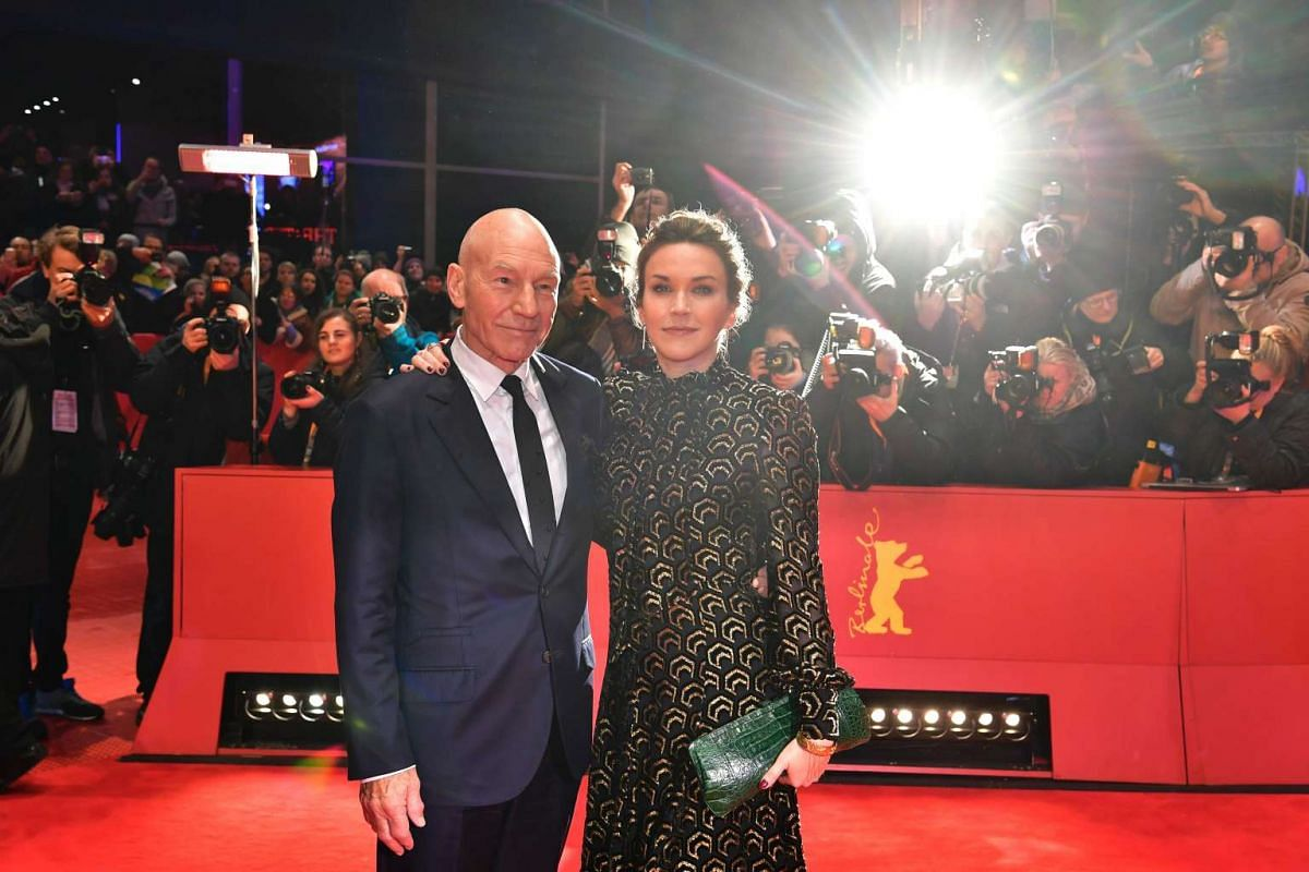 Patrick Stewart and his wife Sunny Ozell pose on the red carpet for the premiere of the film Logan at the 67th Berlinale film festival in Berlin on Feb 17, 2017.