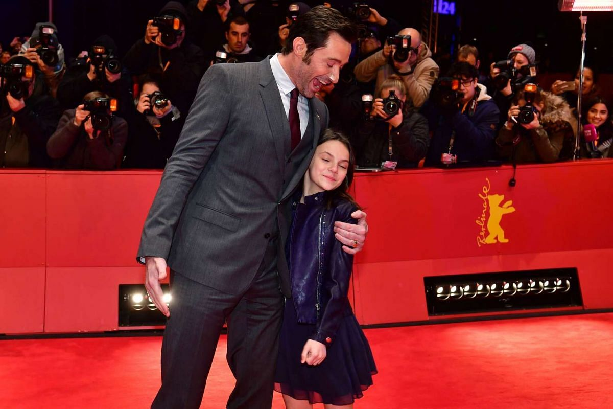 Hugh Jackman and Dafne Keen arrive for the premiere of the film Logan at the 67th Berlinale film festival in Berlin on Feb 17, 2017.