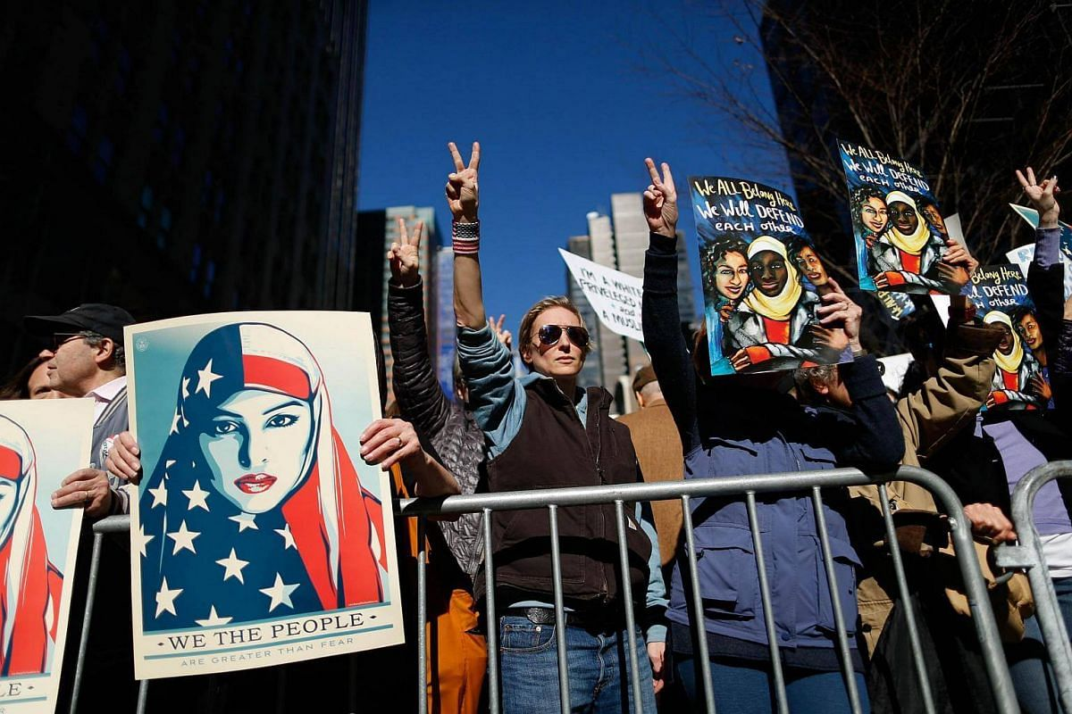 People taking part in a rally called 'I Am A Muslim Too' in a show of solidarity with American Muslims at Times Square on Feb 19, 2017, in New York City.