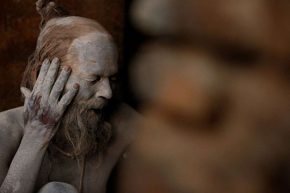 A Hindu holy man smearing ashes on his face at the premises of Pashupatinath Temple, in Kathmandu, Nepal, on Feb 21, 2017.