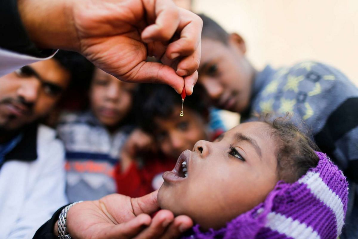 A girl is given vitamin A drops during a house-to-house vaccination campaign in Sanaa, Yemen, on Feb 20, 2017.