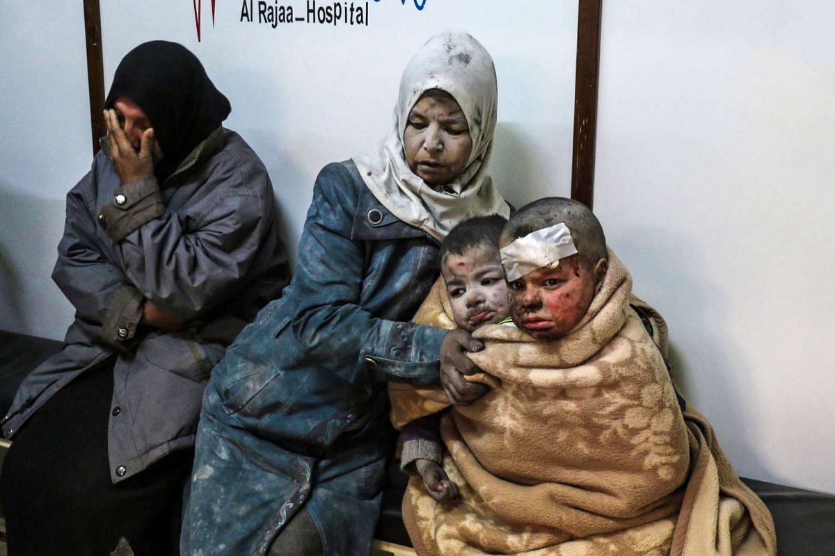 A Syrian woman sitting with injured children at a hospital in the rebel-held distric of Barzah, on the north-eastern outskirts of the capital Damascus, on Feb 20, 2017.