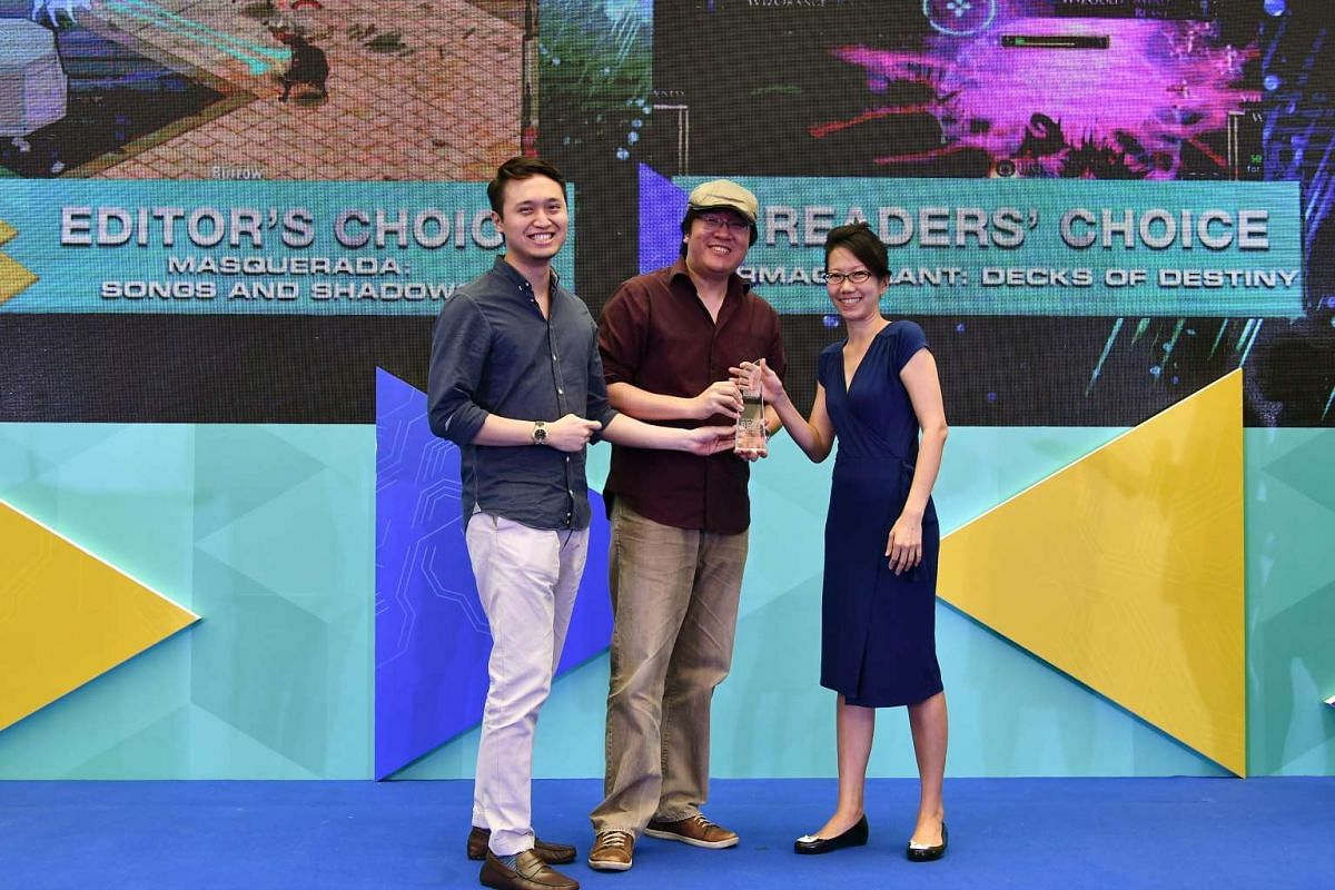 Witching Hour Studios' executive producer Brian Kwek (left) and creative director Ian Gregory Tan receiving the award for best local game from The Straits Times Tech Editor Irene Tham.