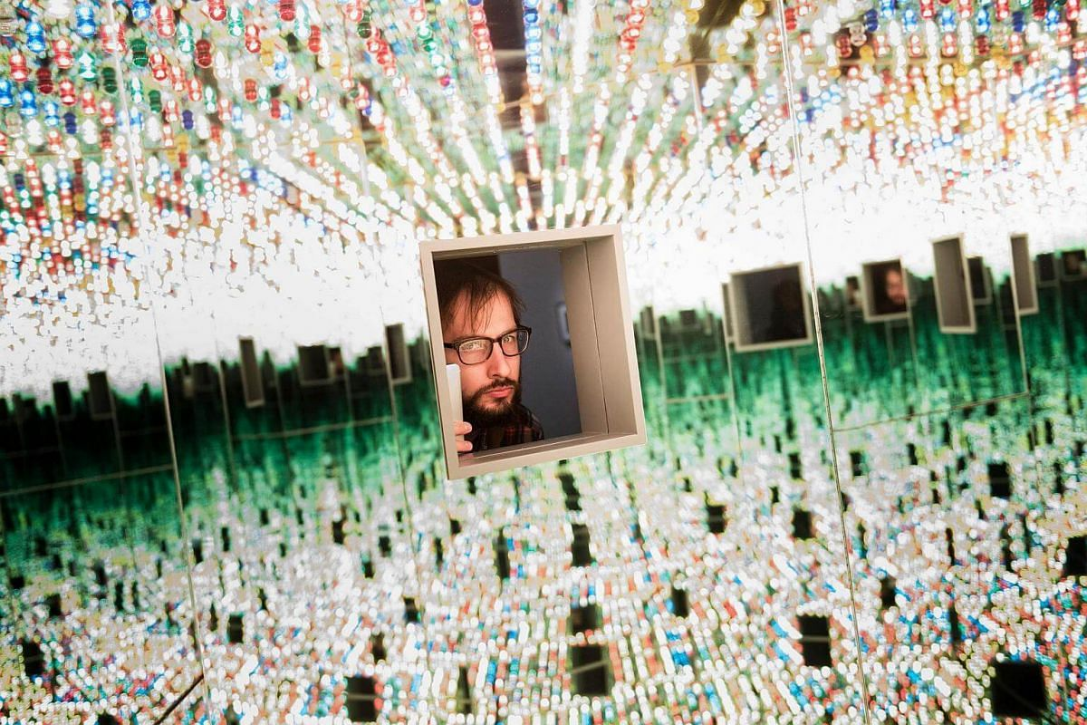 A man looking at the Love Forever room during a preview of the Yayoi Kusama's Infinity Mirrors exhibit at the Hirshhorn Museum, on Feb 21, 2017 in Washington, DC.