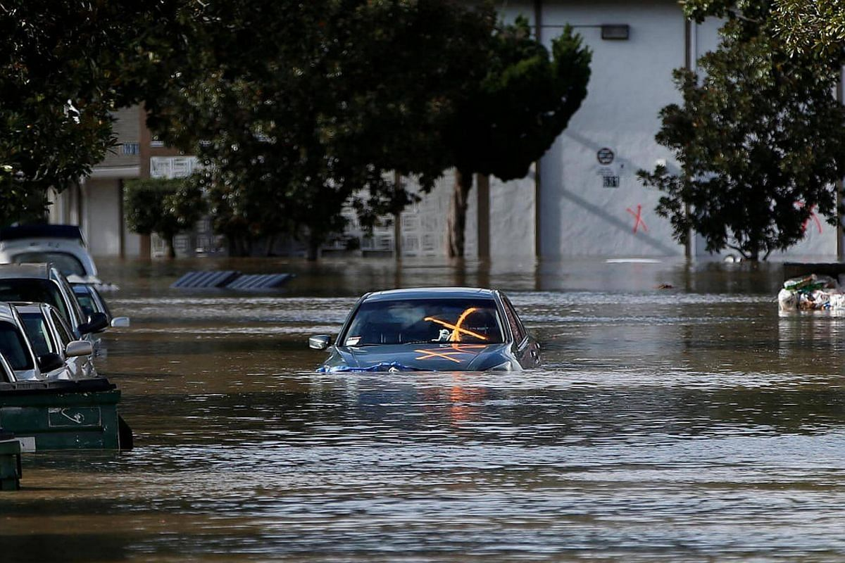 A vehicle is seen partially submerged in flood water after heavy rains overflowed nearby Coyote Creek in San Jose, California, US, on Feb 21, 2017.
