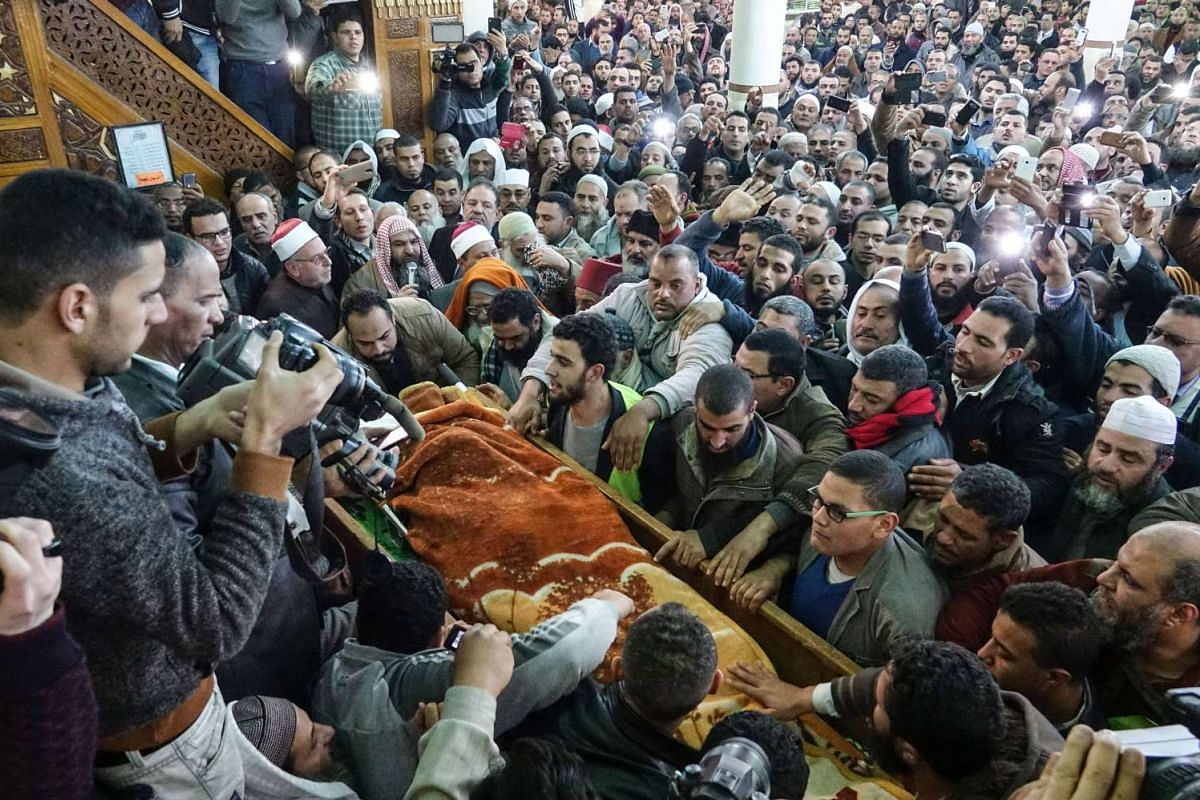 Supporters carrying the coffin of Omar Abdel Rahman, the spiritual leader of the Egyptian extremist Gamaa Islamiya group, at al-Gamaliya town in Dakahlia Governorate, Egypt, on Feb 22, 2017.