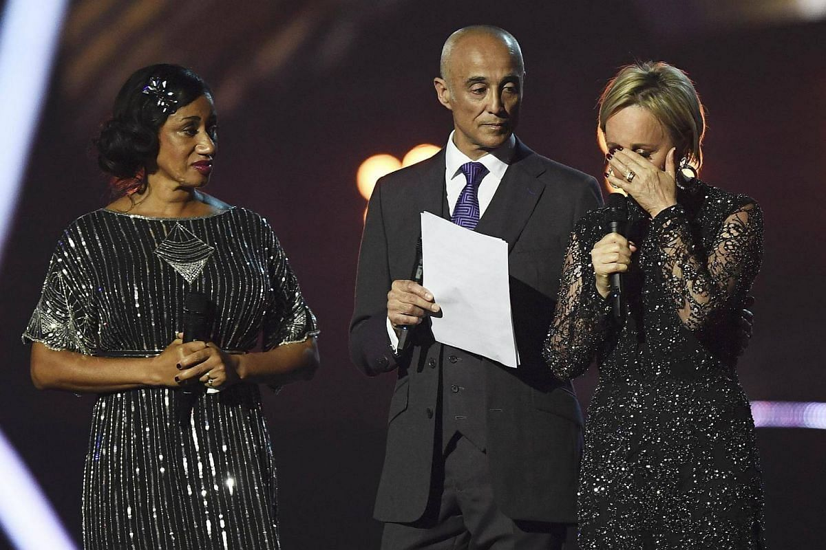 Wham band members Andrew Ridgeley, Pepsi and Shirley pay tribute to George Michael at the Brit Awards at the O2 Arena in London, Britain, on Feb 22, 2017.