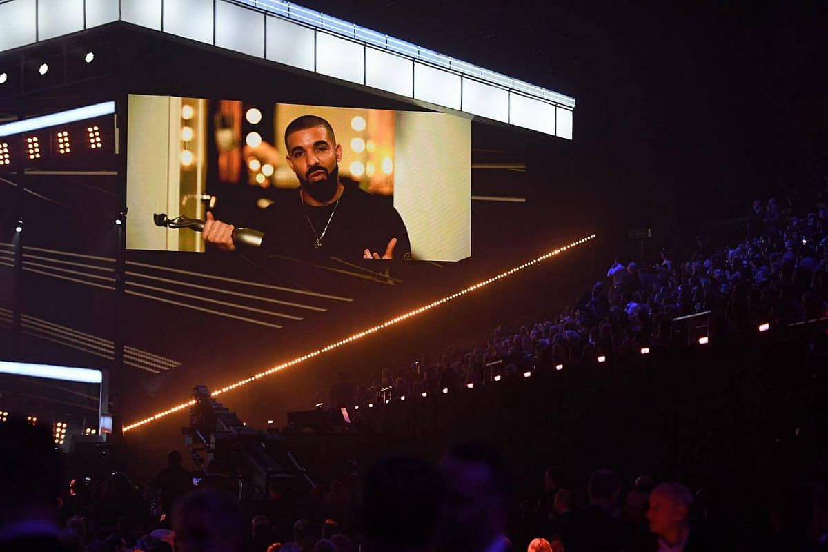 A big screen shows US rapper Drake accepting the award for international male solo artist during the BRIT Awards 2017 ceremony and live show in London on Feb 22, 2017.