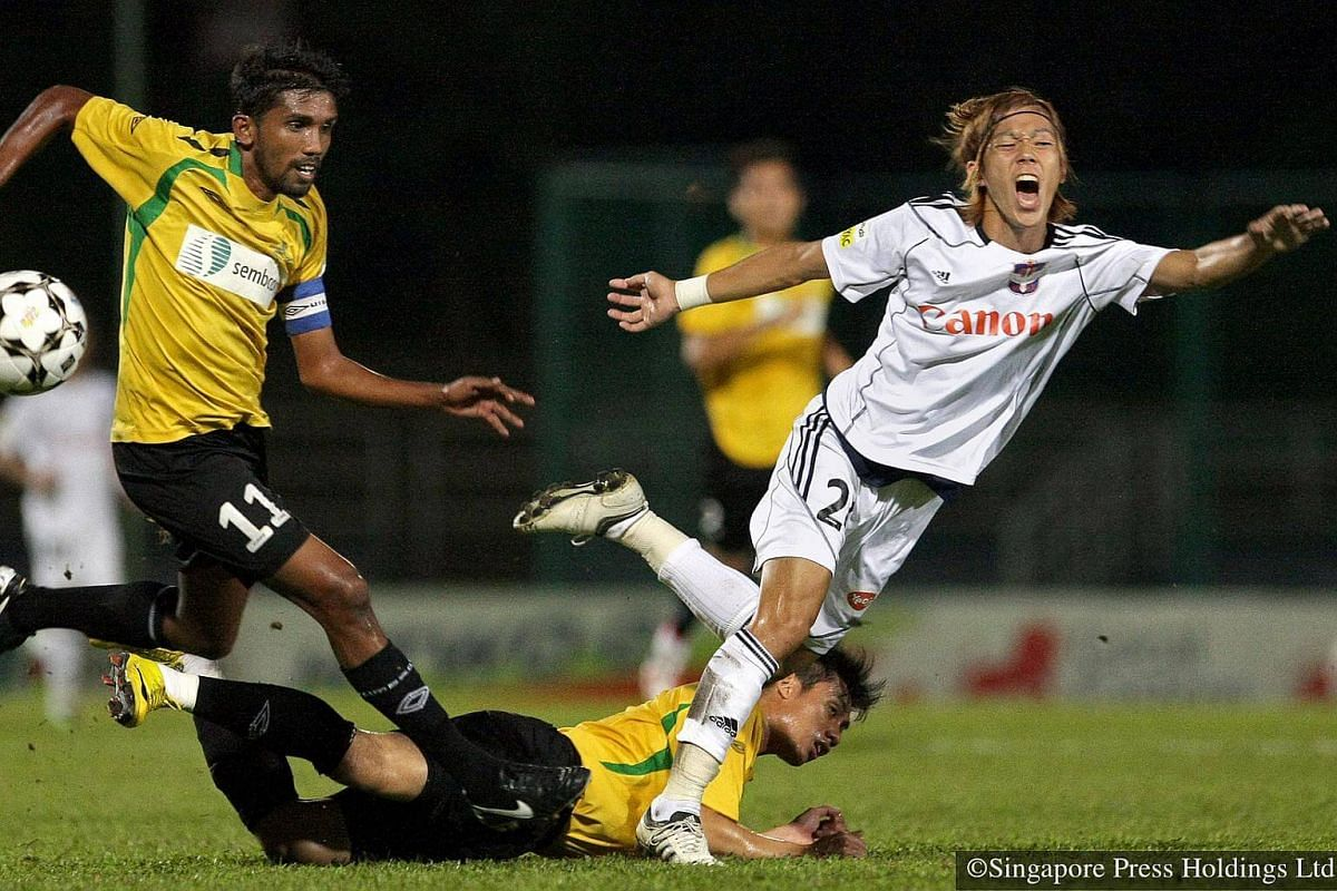 2010: Woodlands Wellington's Noor Ali (left) fights for the ball with Albirex Niigata's Tatsuro Inui at Woodlands Stadium in a Great Eastern-Yeo's S-League football match.