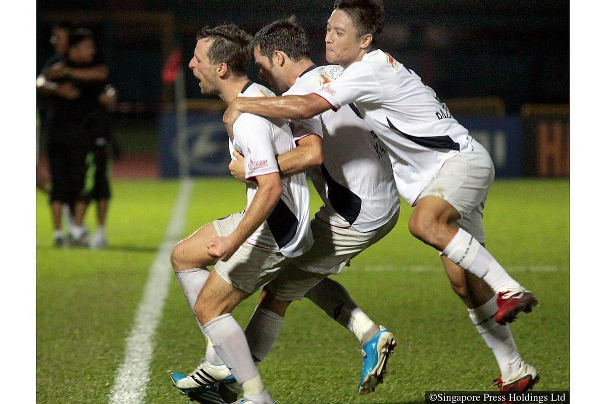 2011: Foreign signings Ivan Jerkovic and Mislav Karoglan from Croatia with their SAFFC teammate Razaleigh Khalik during an S-League match against Tampines Rovers held at Tampines Stadium.