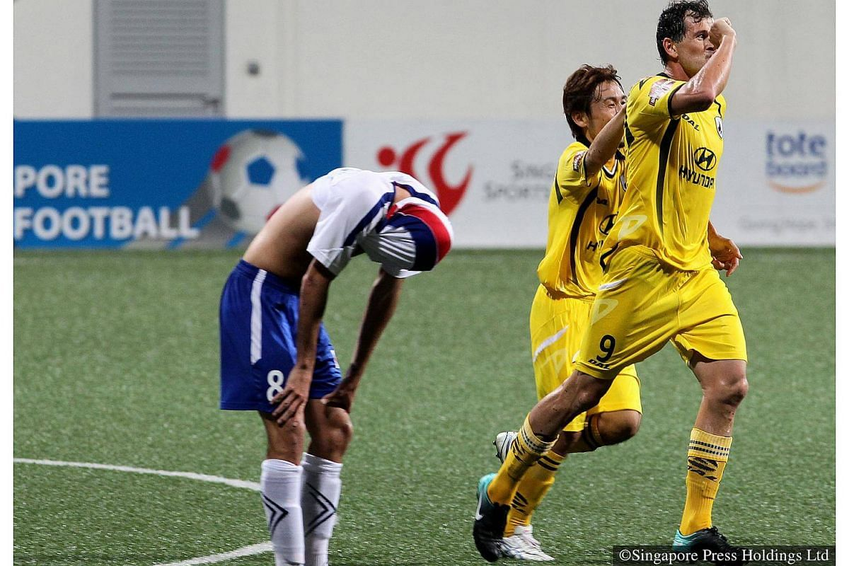 2011: The curtain raiser for the 2011 S-League season is this Charity Shield match between Etoile FC and Tampines Rovers held at Jalan Besar Stadium. Etoile midfielder Theo Raymond reacts after Tampines Rovers's striker Aleksandar Duric scores an e