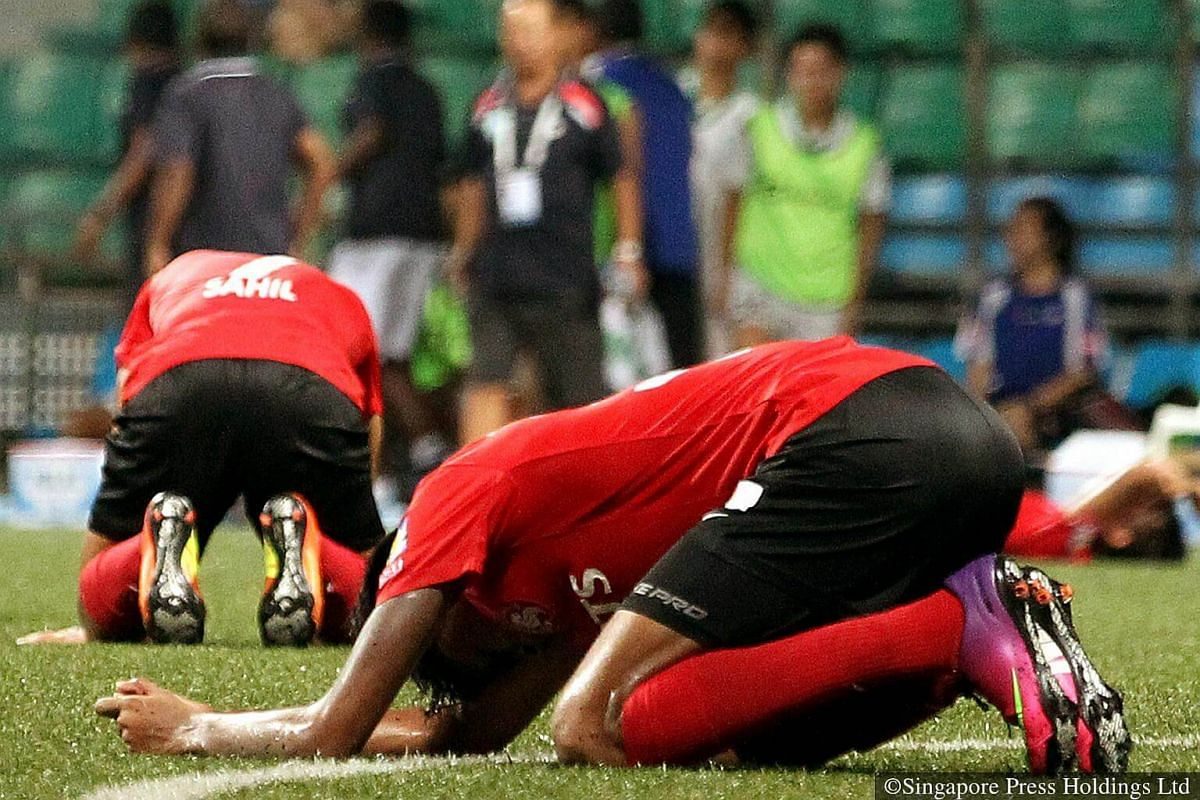 2013: Courts Young Lions' players react in disappointment after losing the match with Geylang International by a goal and being the only team in the 2013 season thus far to not have any points, having lost all 12 matches they had played.
