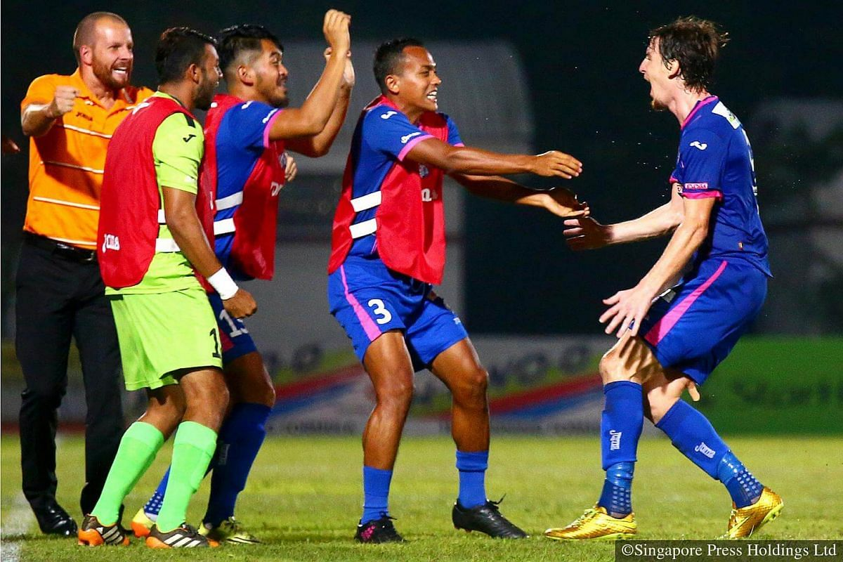 2014: Former NK Zagreb striker Miroslav Pejic (right) celebrating with his teammates and coach Alex Weaver (left) of Warriors FC after winning 2-1 against Tampines Rovers in a crucial Great Eastern-Yeo's S-League clash. Warriors FC is a club with r