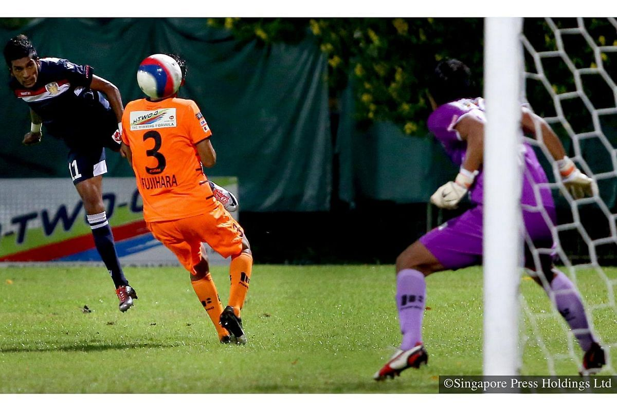 2014: A heart-in-mouth moment when Hougang United's Fazli Jaffar (left) goes for the ball and scores with this excellent header during a match against Albirex Niigata at Jurong East Stadium to win 1-0.