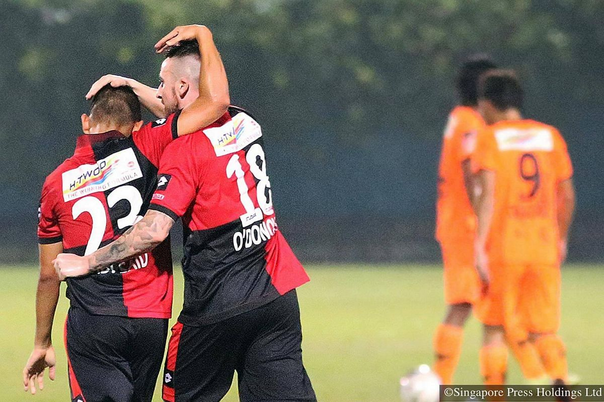 2014: Patting each other's head in jubilation after an unmarked Adi Said gleefully heads home the winning goal created by Roy O'Donovan (right) during a match between S-League's two foreign clubs, Albirex Niigata and Brunei DPMM at Jurong East