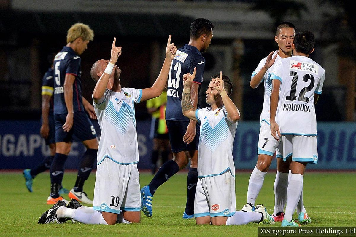 2016: Thanking the heavens are Brunei DPMM's deadly duo Rafael Ramazotti (kneeling, left) and teammate Paulo Sergio (also kneeling) after scoring a goal in their Great Eastern-Yeo's S-League clash against Warriors FC at the Choa Chu Kang Stadium.