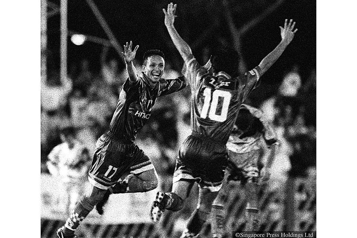 1996: Local football legend Fandi Ahmad celebrates with team-mate Syed Farouk during a match between Geylang United and SAFFC from the highly successful S-League Tiger Beer Series.