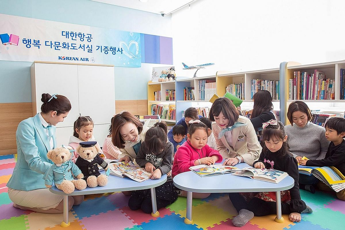 Korean Air stewardesses reading to children at a multicultural library in Gangseo district in western Seoul. The airline has donated 3,200 books in various languages to the library as part of its CSR efforts. Mr Seo Seong Youl, who runs a 1913 Songje