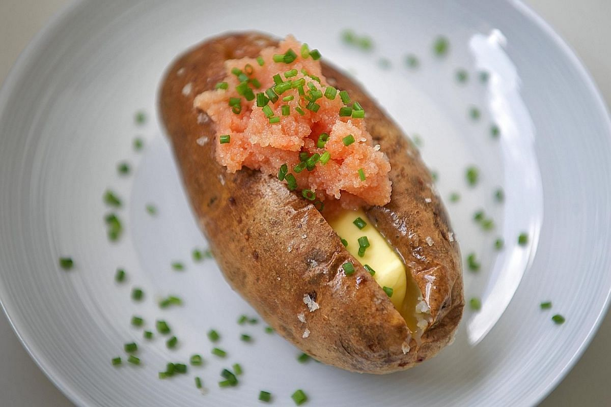 Use Russet potatoes for fluffy insides and top them with spicy pollock roe from Japanese supermarkets.