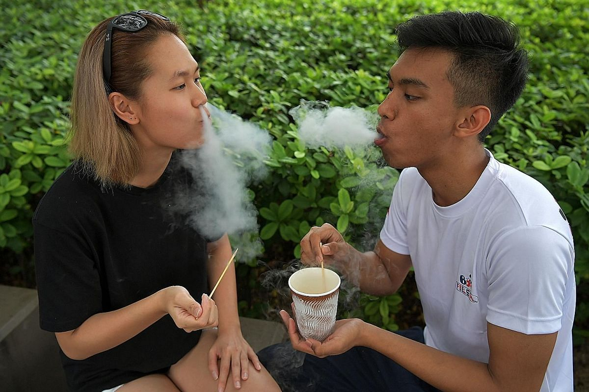 A staff member at Coyoro prepares the dessert using liquid nitrogen. Abracowdabra's co-owner Evelyn Wang and colleague Mohd Noor Shahlihin Mohd Salleh taking a breather with Dragon's Breath.