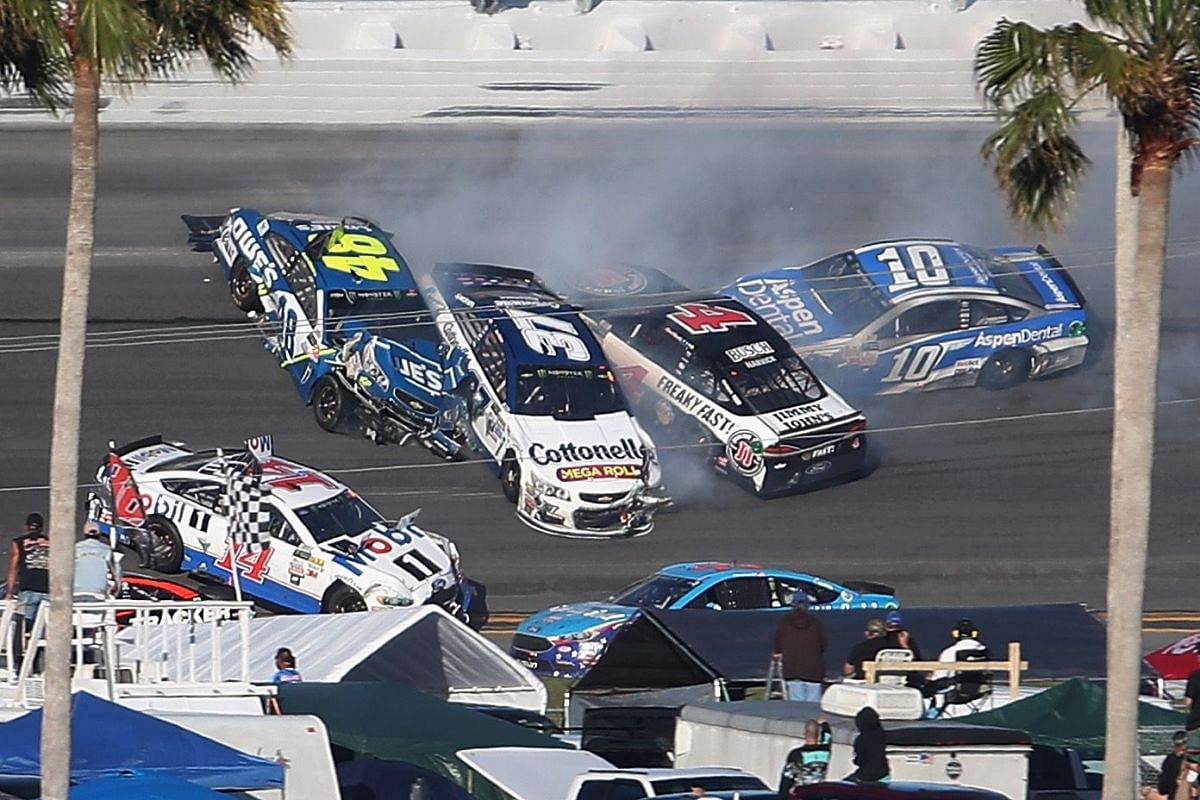 Jimmie Johnson, driver of the #48 Lowe's Chevrolet, Kevin Harvick, driver of the #4 Jimmy John's Ford, Danica Patrick, driver of the #10 Aspen Dental Ford, and Clint Bowyer, driver of the #14 Mobil 1 Ford, were involved in an on-track incident during