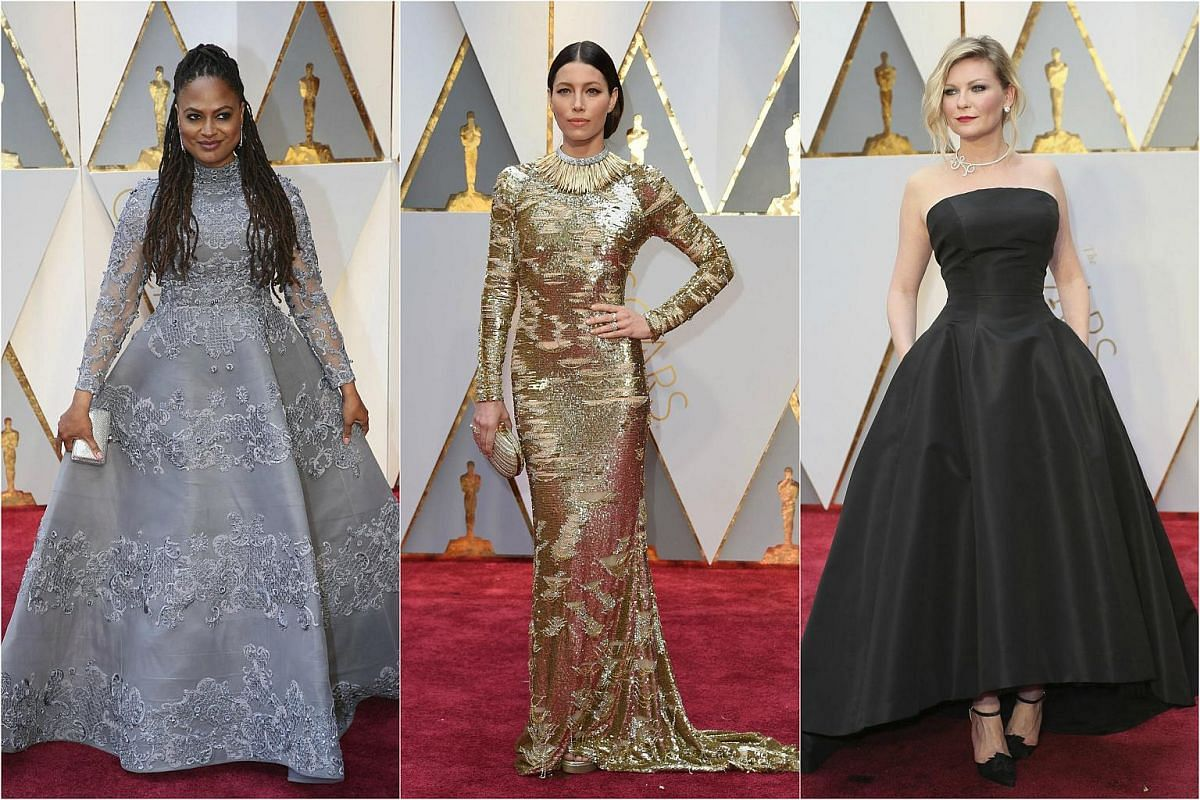 (From left) Ava DuVernay, Jessica Biel and Kirsten Dunst posing on the red carpet during the 89th Academy Awards in Hollywood, California, on Feb 26, 2017.