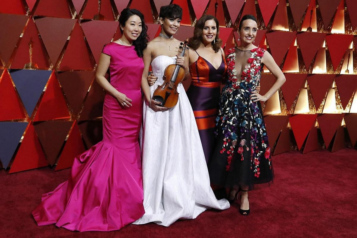 Directors and cast members of Joe's Violin arriving on the red carpet during the 89th Academy Awards in Hollywood, California, on Feb 26, 2017.