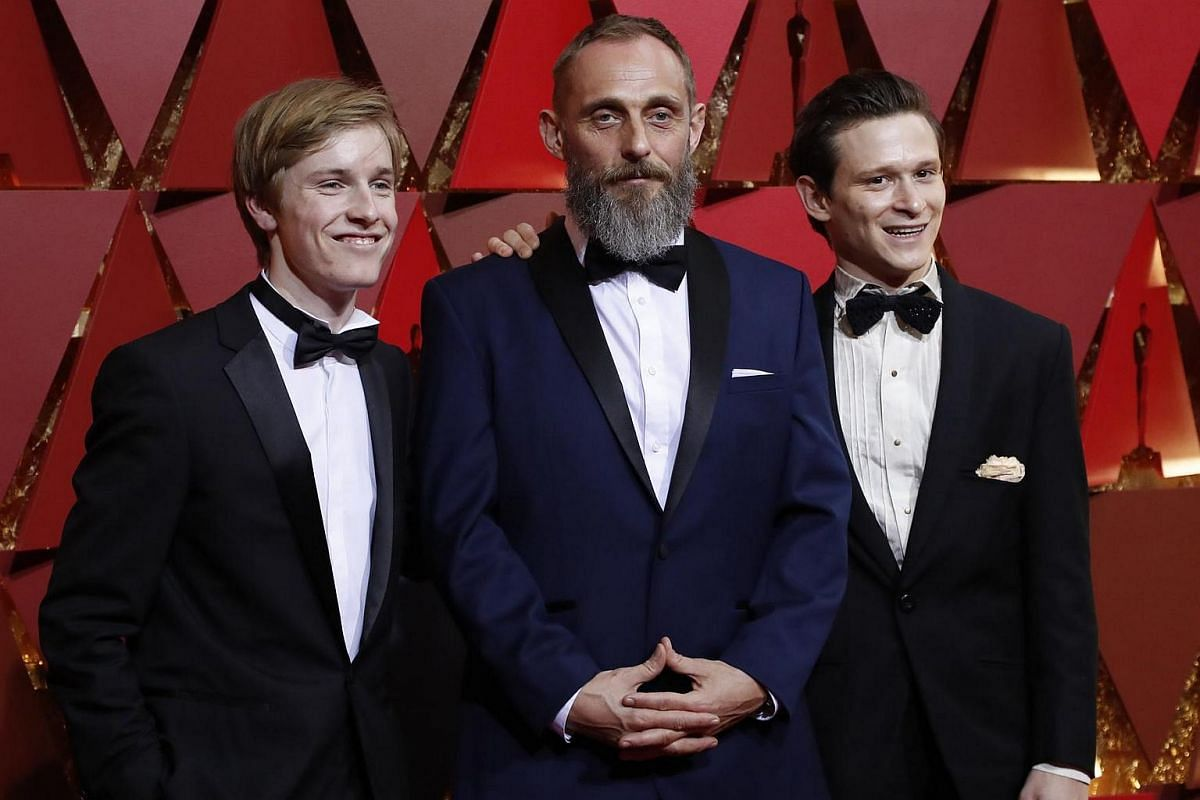 Actors Louis Hofmann, Roland Moller, Joel Basman arriving on the red carpet during the 89th Academy Awards in Hollywood, California, on Feb 26, 2017.