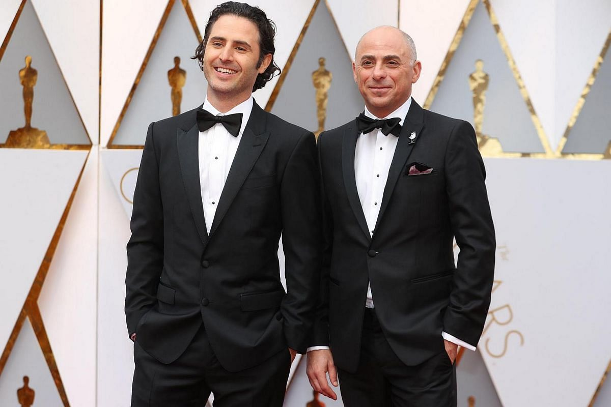 Director Alan Barillaro and Producer Marc Sondheimer posing on the red carpet during the 89th Academy Awards in Hollywood, California, on Feb 26, 2017.