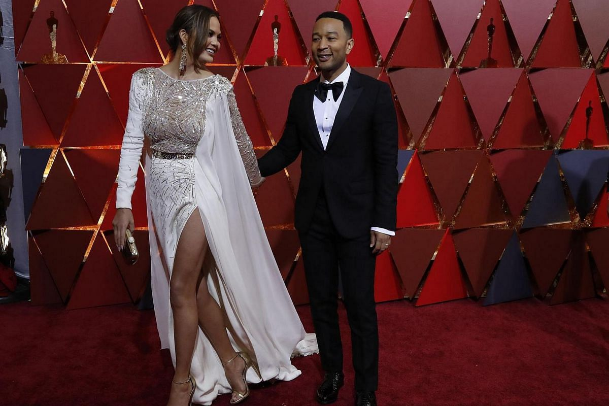 John Legend (left) and wife Chrissy Teigen arriving on the red carpet for the 89th Oscars, on Feb 26, 2017.