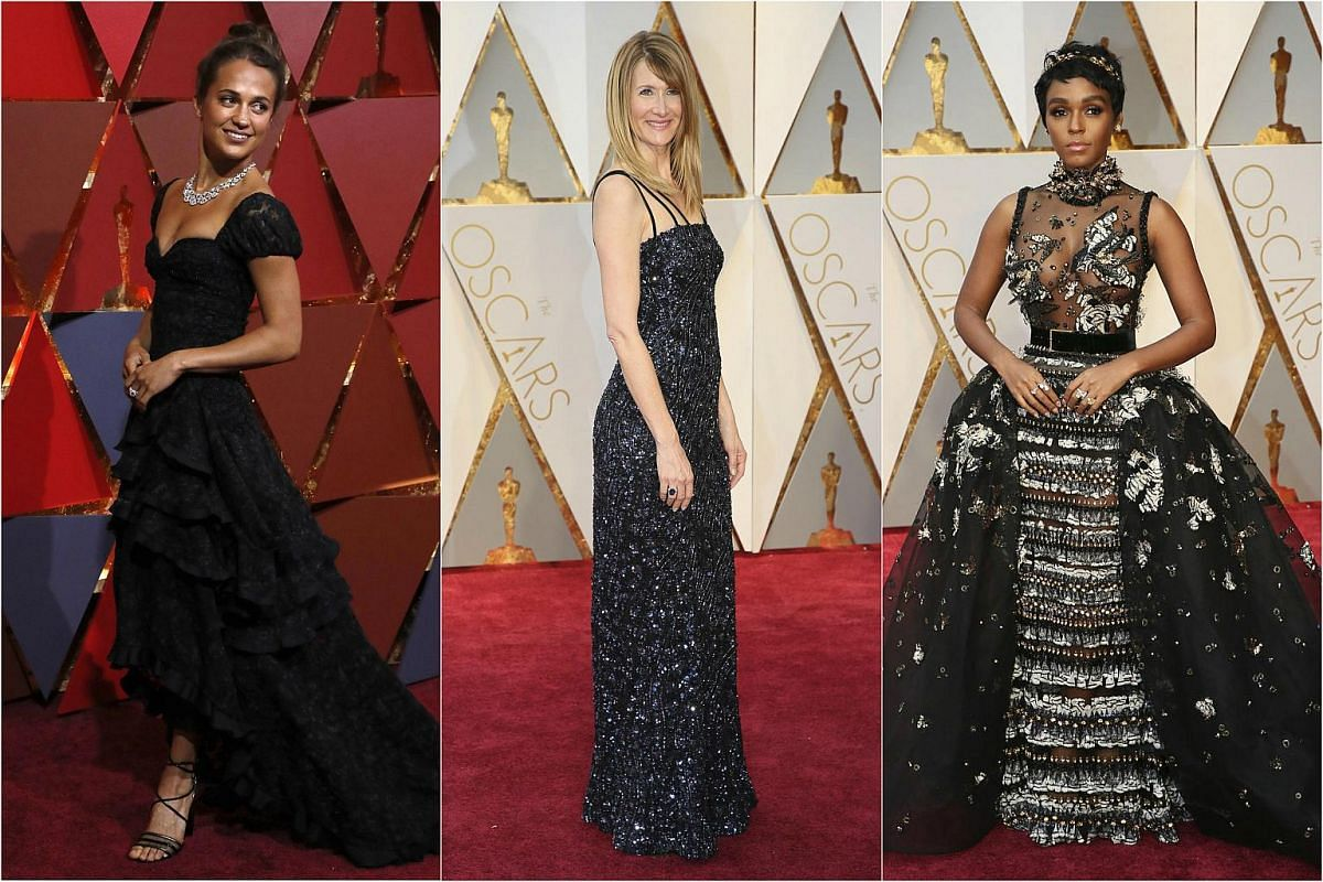 (From left) Alicia Vikander, Laura Dern and Janelle Monae posing on the red carpet for the 89th Oscars, on Feb 26, 2017.