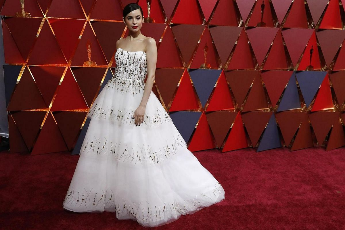 Actress and singer Sofia Carson posing on the red carpet during the 89th Academy Awards in Hollywood, California, on Feb 26, 2017.