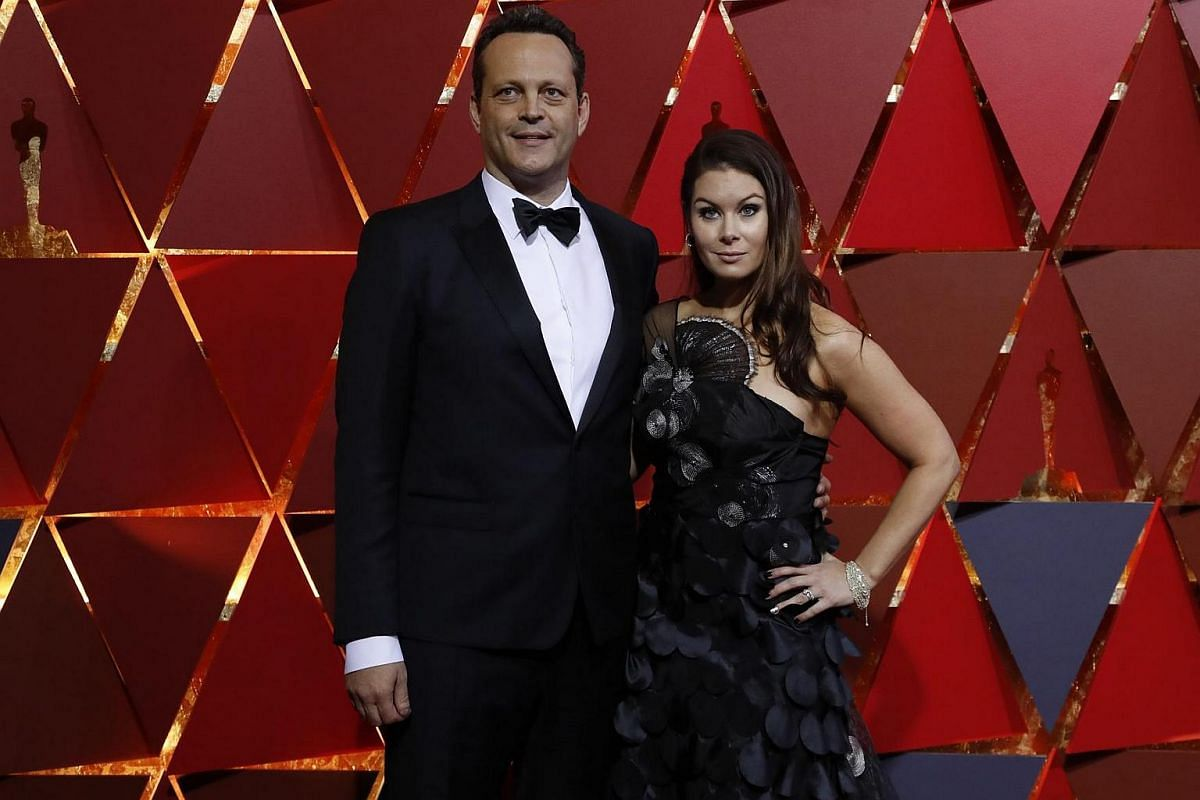 Vince Vaughn and wife Kyla Weber posing on the red carpet for the 89th Oscars, on Feb 26, 2017.