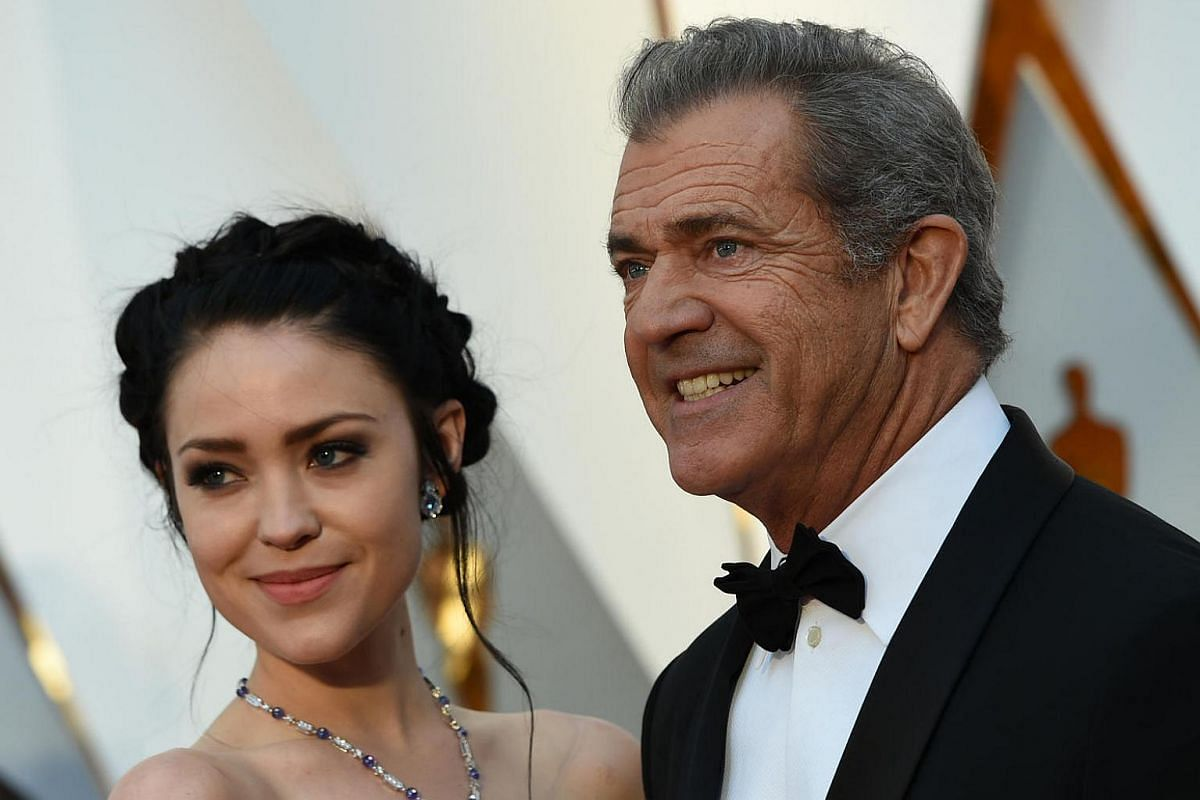 Nominee for Best Director Hacksaw Ridge Mel Gibson (right) and his girlfriend Rosalind Ross posing on the red carpet for the 89th Oscars, on Feb 26, 2017.