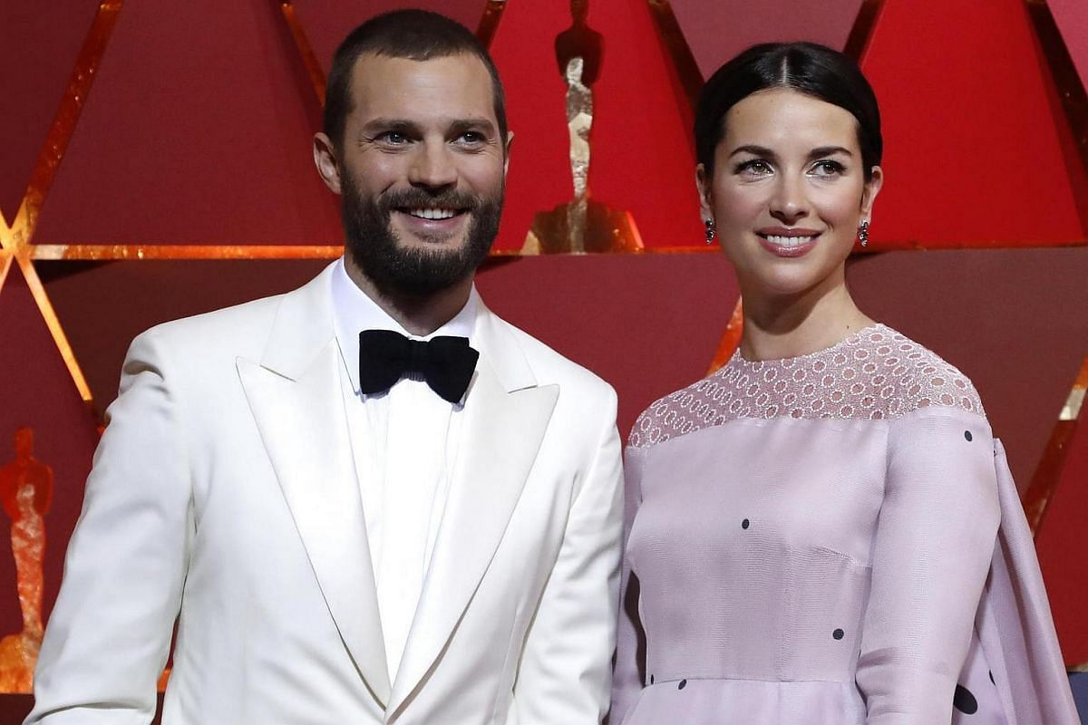 Jamie Dornan and his wife Amelia Warner posing on the red carpet for the 89th Oscars, on Feb 26, 2017.