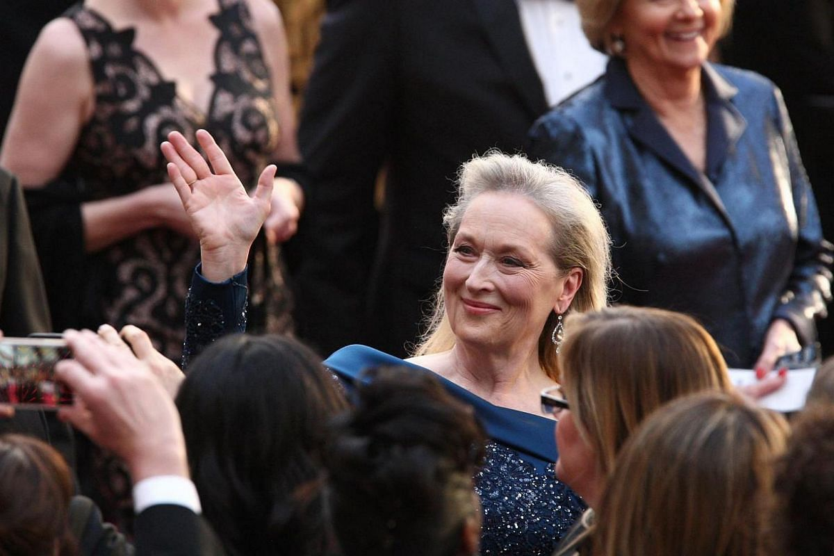 US actress Meryl Streep posing for fans as she arrives on the red carpet for the 89th Oscars on Feb 26, 2017 in Hollywood, California.