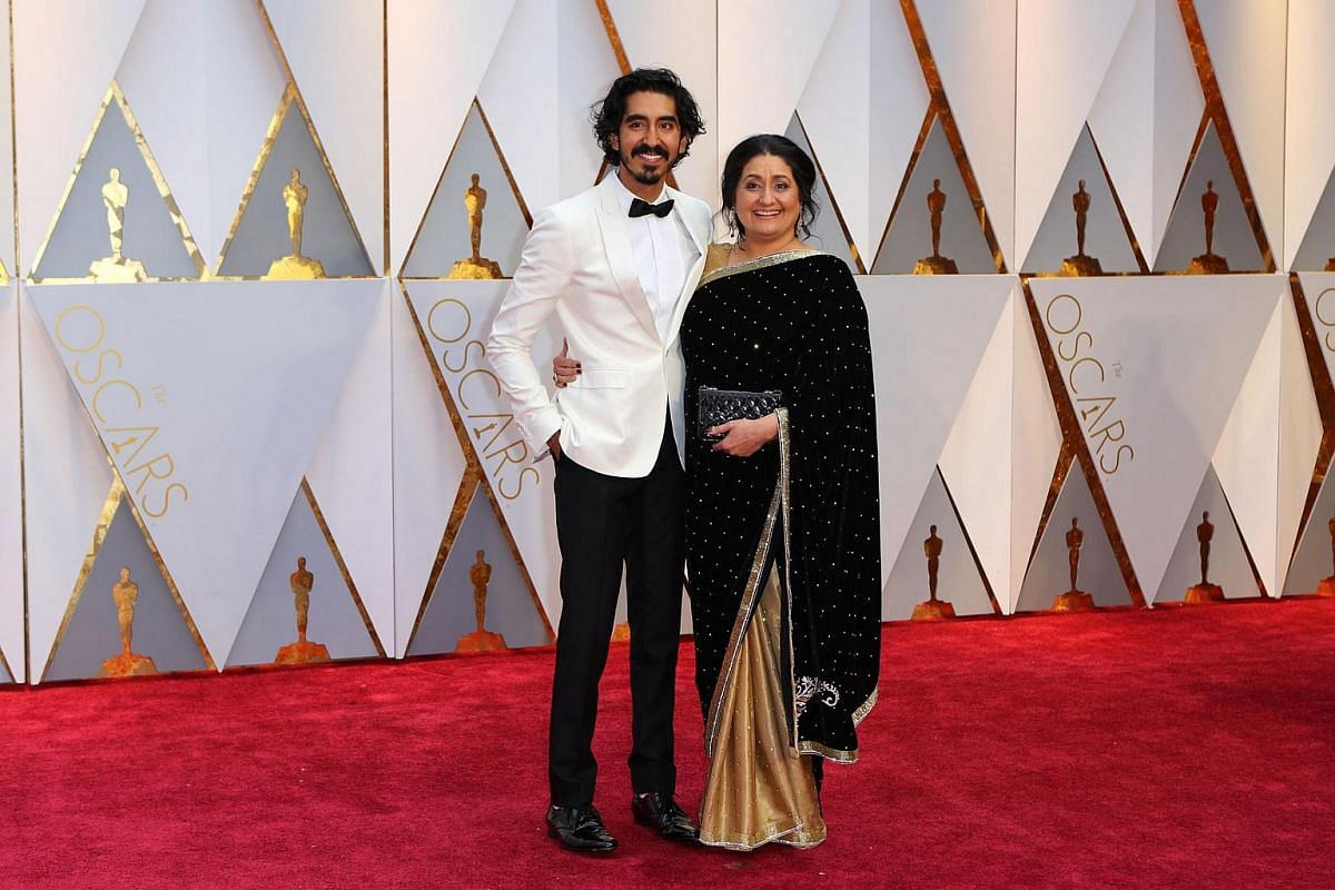 Dev Patel and his mother arriving on the red carpet for the 89th Oscars on Feb 26, 2017, in Hollywood, California.