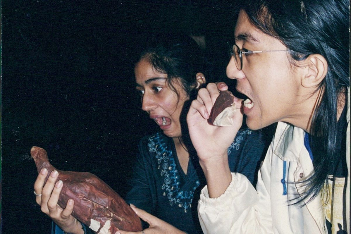 My Life So Far: Jaswal doing performance art with a prop roast chicken when she was 16 or 17.