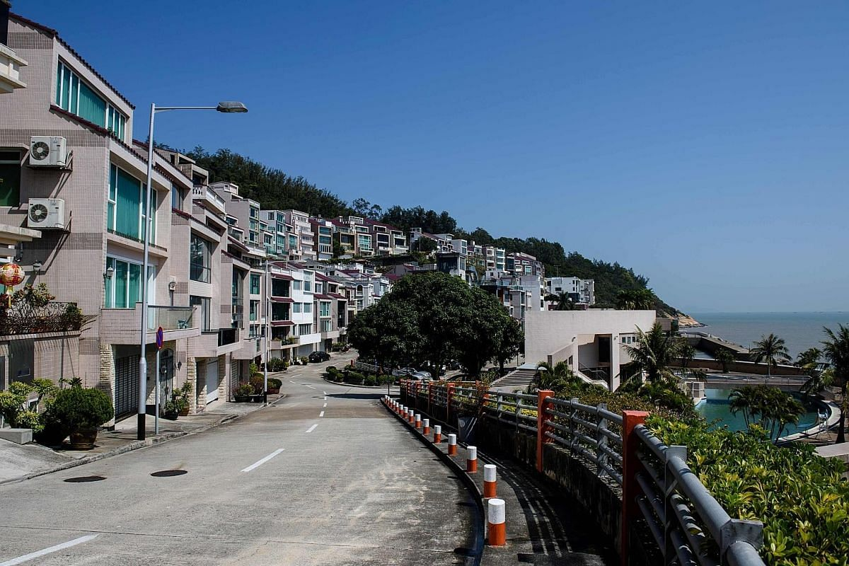 The street outside an oceanfront villa (centre left), one of the properties where Mr Kim Jong Nam was believed to have lived in Macau. Even though he lived overseas, Mr Kim was still seen as a threat by Pyongyang. Mr Kim Jong Il with his youngest son