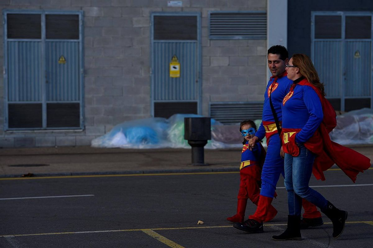 A family dressed in Superman costumes attend carnival celebrations in Gijon, northern Spain.