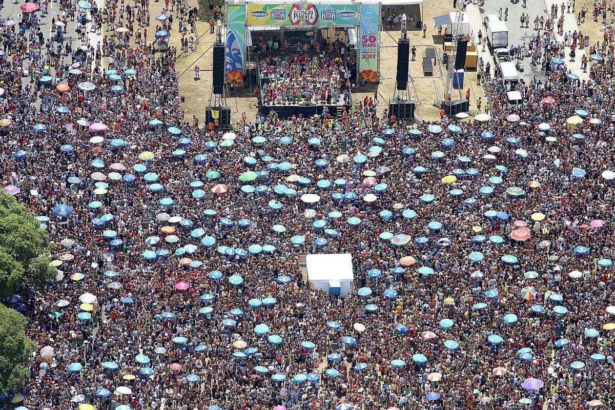 A general view of thousands of people as they gather at the Aterro do Flamengo watching the Sargento Pimenta (Sargent Pepper) show, which combines samba music and The Beatles songs, during the celebrations of the Rio Carnival, in Rio de Janeiro, Braz