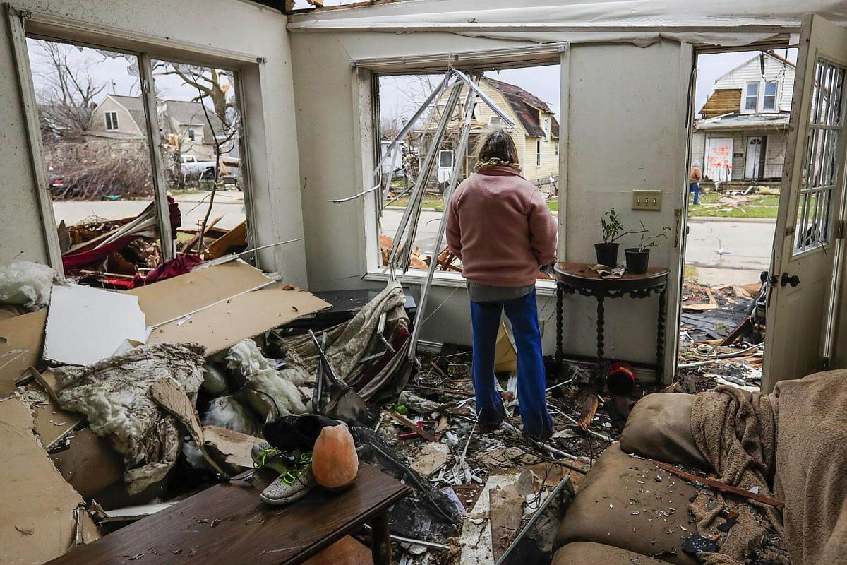 Debbie Loughridge looking out the window of her living room after a tornado destroyed her home in Naplate, Illinois, US, on March 1, 2017.