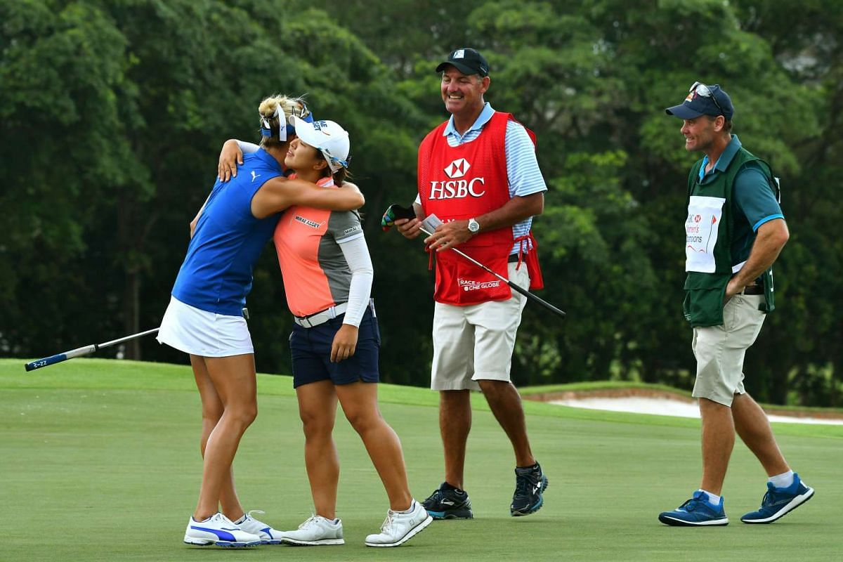 Sei Young Kim from Republic of Korea hugging Lexi Thompson from US (left), at the end of the opening round of the HSBC Women's Champions at Sentosa Golf Club, on March 2, 2017.